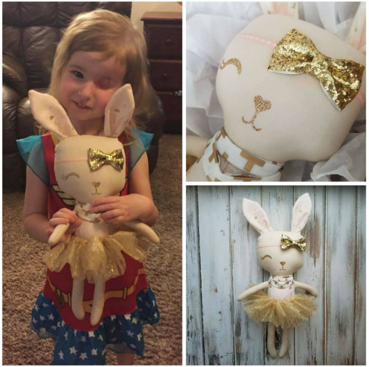 Little girl with custom-made Sebastian Designs doll (Sebastian Designs/Facebook)