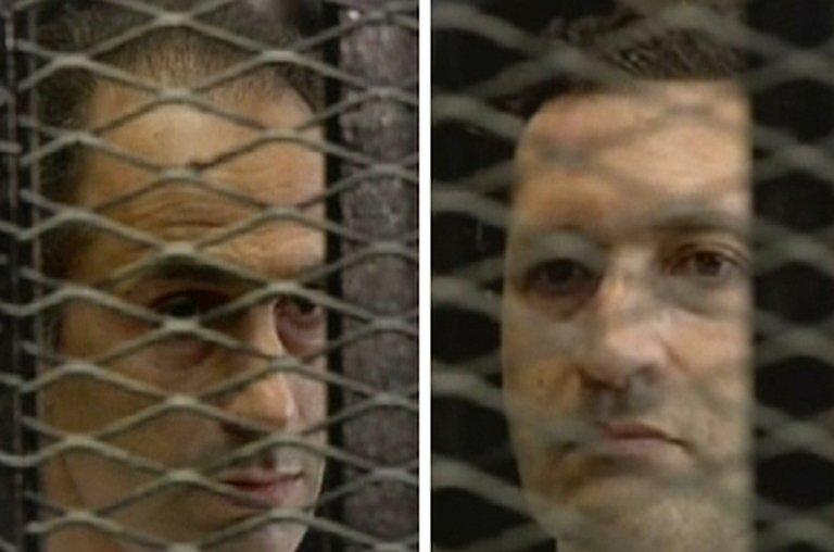 Gamal (left) and Alaa Mubarak listen to the verdict in their father's trial at a court in Cairo on June 2, 2012