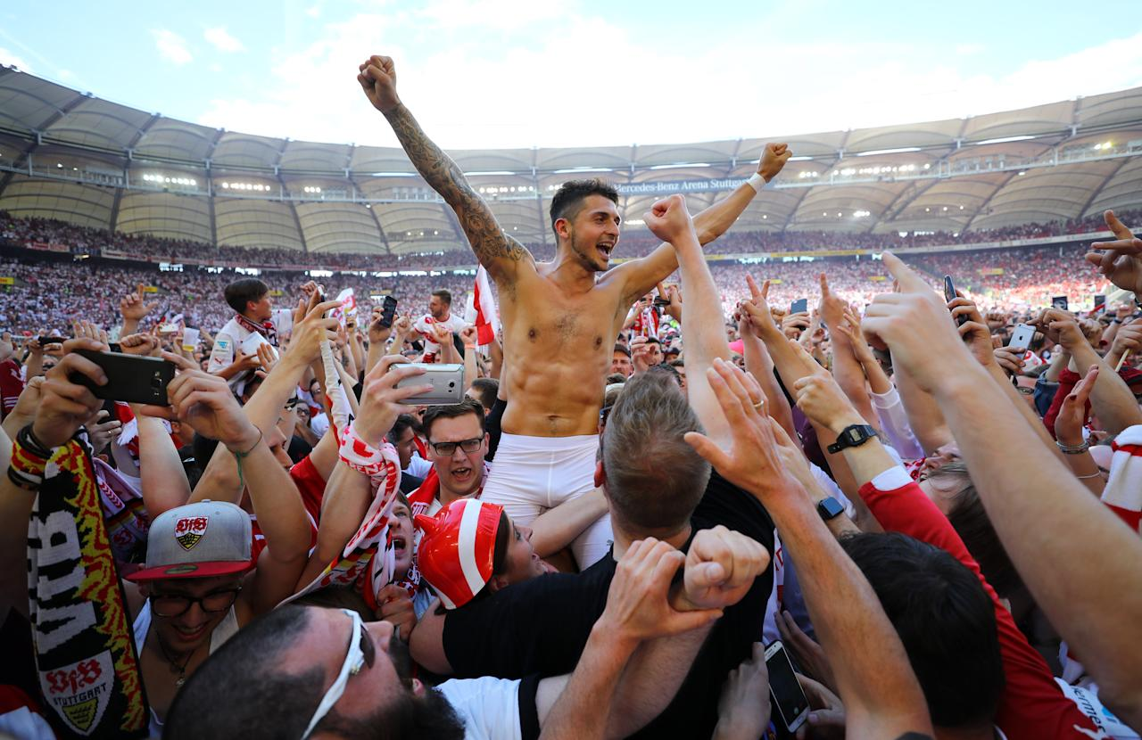 Football Soccer - VfB Stuttgart v Wurzburger Kickers - 2. Bundesliga - Mercedes-Benz Arena, Stuttgart, Germany - 21/5/17 VfB Stuttgart's Matthias Zimmermann celebrates promotion with fans on the pitch after the match Reuters / Kai Pfaffenbach Livepic DFL RULES TO LIMIT THE ONLINE USAGE DURING MATCH TIME TO 15 PICTURES PER GAME. IMAGE SEQUENCES TO SIMULATE VIDEO IS NOT ALLOWED AT ANY TIME. FOR FURTHER QUERIES PLEASE CONTACT DFL DIRECTLY AT + 49 69 650050.