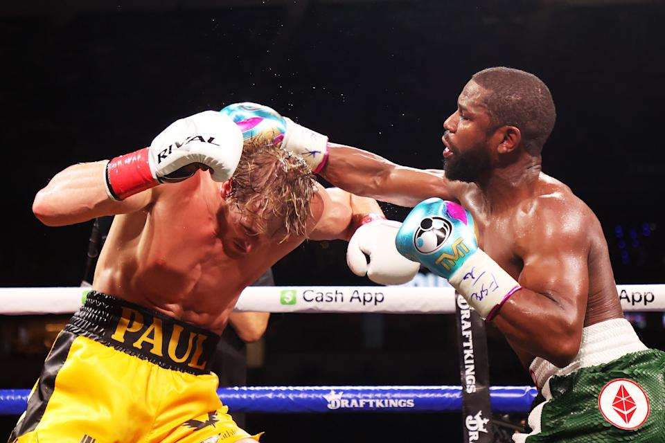 Floyd Mayweather (pictured right) exchanges blows with Logan Paul (pictured left) during their contracted exhibition boxing match at Hard Rock Stadium on June 06, 2021 in Miami Gardens, Florida.
