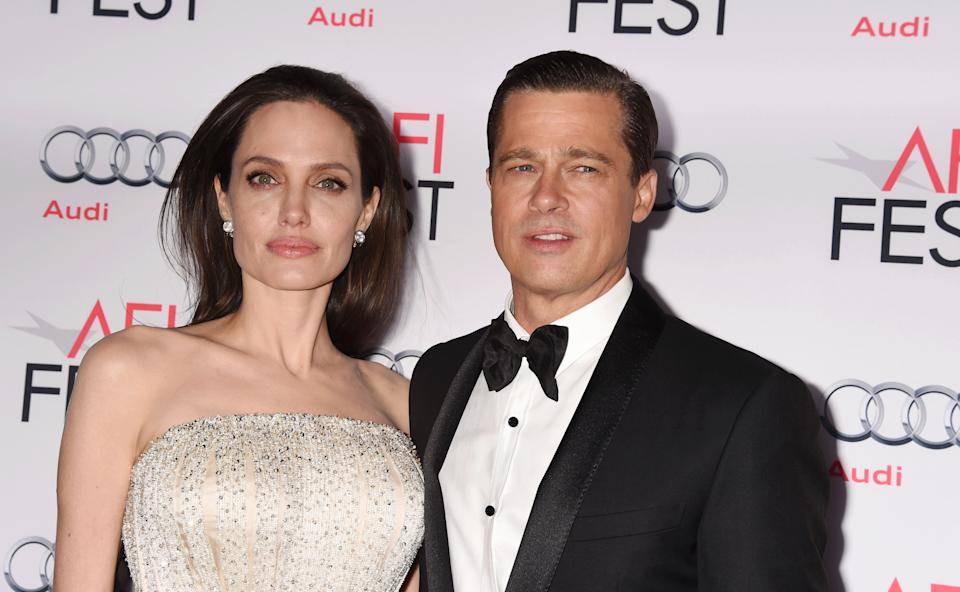 HOLLYWOOD, CA - NOVEMBER 05:  Writer-director-producer-actress Angelina Jolie Pitt (L) and actor-producer Brad Pitt arrive at the AFI FEST 2015 presented by Audi Opening Night Gala Premiere of Universal Pictures' 'By The Sea' at TCL Chinese 6 Theatres on November 5, 2015 in Hollywood, California.(Photo by Jeffrey Mayer/WireImage)
