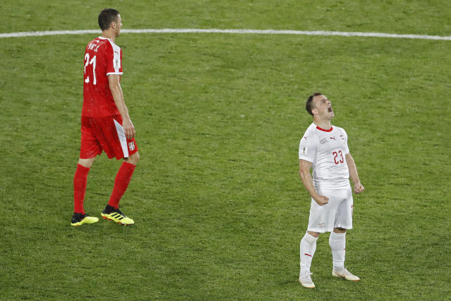 Switzerland's Xherdan Shaqiri, right, celebrates next to Serbia's Nemanja Matic after scoring his side's second goal during the group E match between Switzerland and Serbia at the 2018 soccer World Cup in the Kaliningrad Stadium in Kaliningrad, Russia, Friday, June 22, 2018. Shaqiri scored once in Switzerland's 2-1 victory. (AP Photo/Antonio Calanni)