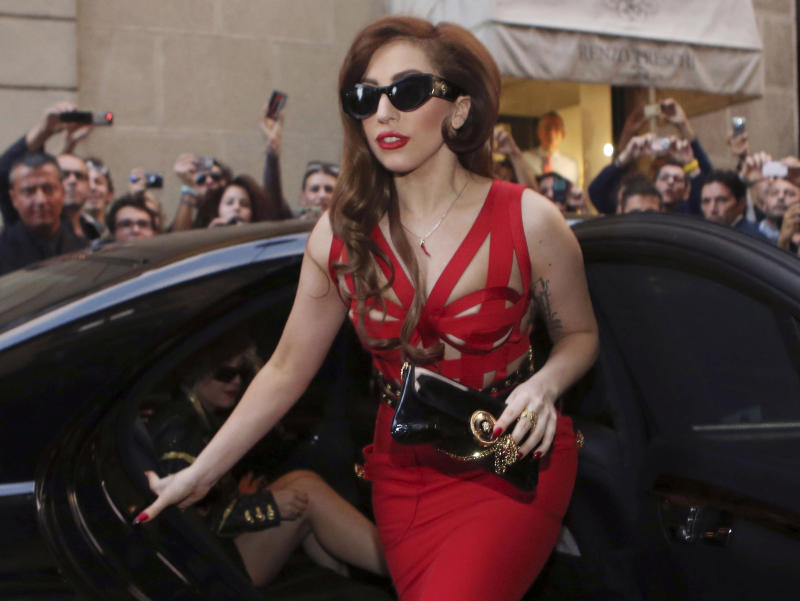 FILE - This Oct. 1, 2012 file photo shows Lady Gaga arriving at the Versace atelier in Milan, Italy. A person familiar with the inauguration tells The Associated Press that the pop star will perform at Tuesday's ball for White House staffers. The source spoke on condition of anonymity because that person wasn't authorized to publicly reveal the information. (AP Photo/Luca Bruno, File)