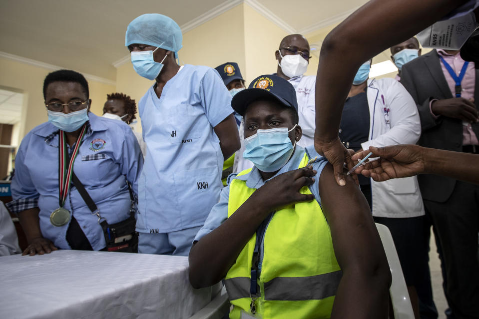 A hospital security guard receives one of the country's first coronavirus vaccinations using AstraZeneca COVID-19 vaccine manufactured by the Serum Institute of India and provided through the global COVAX initiative, at Kenyatta National Hospital in Nairobi, Kenya Friday, March 5, 2021. Urgent calls for COVID-19 vaccine fairness rang through African countries on Friday as more welcomed or rolled out doses from the global COVAX initiative, with officials acutely aware their continent needs much more. (AP Photo/Ben Curtis)