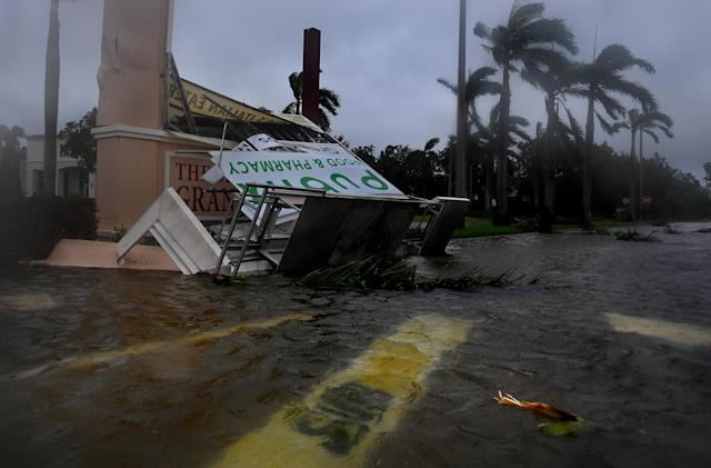 <p><strong>Estero</strong><br> A Subway sandwich shop sign is submerged (foreground) and a Publix grocery story sign is badly damaged in Estero, Florida after Hurricane Irma came through with the lead band of strength. (Photo: Michael S. Williamson/The Washington Post via Getty Images) </p>
