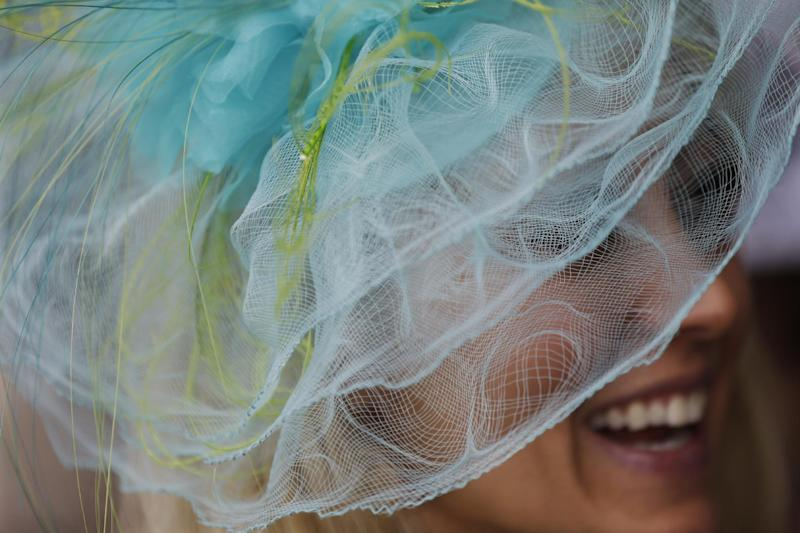 Dana Settles wears a fancy hat during the 139th Kentucky Derby at Churchill Downs Saturday, May 4, 2013, in Louisville, Ky. (AP Photo/David Goldman)