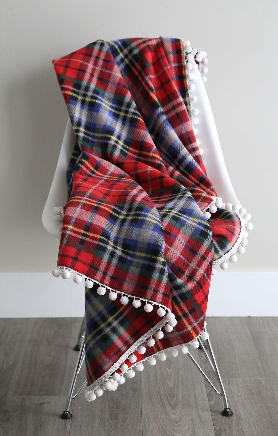 """<p>Give the gift of warmth this Christmas with a cozy fleece blanket you can make yourself. </p><p><strong>Get the tutorial at <a href=""""https://www.itsalwaysautumn.com/easy-beautiful-diy-fleece-blankets.html"""" rel=""""nofollow noopener"""" target=""""_blank"""" data-ylk=""""slk:It's Always Autumn"""" class=""""link rapid-noclick-resp"""">It's Always Autumn</a>.</strong></p><p><strong><strong><a class=""""link rapid-noclick-resp"""" href=""""https://go.redirectingat.com?id=74968X1596630&url=https%3A%2F%2Fwww.joann.com%2Fluxe-fleece-fabric-59-bright-gray-heathered-plaids%2F15149826.html&sref=https%3A%2F%2Fwww.countryliving.com%2Fdiy-crafts%2Ftips%2Fg645%2Fcrafty-christmas-presents-ideas%2F"""" rel=""""nofollow noopener"""" target=""""_blank"""" data-ylk=""""slk:SHOP FLEECE"""">SHOP FLEECE</a></strong><br></strong></p>"""