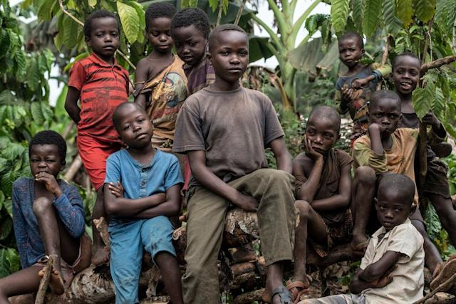 Children pose for a photo outside a rural village in Congo. Monkeypox was traced back to this country in 1970.
