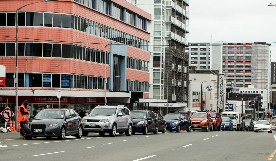 Cars queue outside a COVID-19 testing station in Wellington, New Zealand, Wednesday, June, 23, 2021. After enjoying nearly four months without any community transmission of the coronavirus, New Zealanders were on edge Wednesday after health authorities said an infectious traveler from Australia had visited over the weekend. (Jack Crossland/NZ Herald via AP)