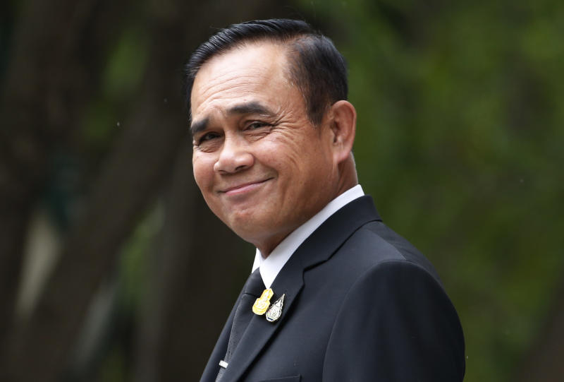 Thailand's Prime Minister Prayuth Chan-ocha smiles as he talks to reporters before meeting at government house in Bangkok, Thailand, Thursday, June 6, 2019. Thailand's Parliament elected 2014 coup leader Prayuth Chan-ocha as prime minister in a vote Wednesday that helps ensure the military's sustained dominance of politics since the country became a constitutional monarchy nearly nine decades ago. (AP Photo/Sakchai Lalit)