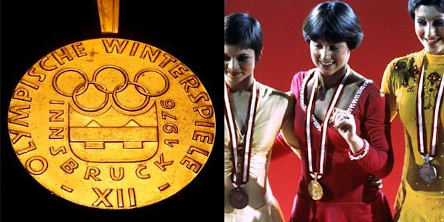 <p>A close-up of a gold medal from the 1976 Olympics in Innsbruck, Austria. It was given to Dorothy Hamill for winning the Individual Women's Figure Skating event.<br>(AP Photo/Tina Fineberg; USA's Dorothy Hamill/photo by Tony Duffy/Getty Images) </p>