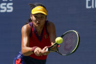 Emma Raducanu, of Great Britain, returns a shot to Belinda Bencic, of Switzerland, during the quarterfinals of the US Open tennis championships, Wednesday, Sept. 8, 2021, in New York. (AP Photo/Elise Amendola)