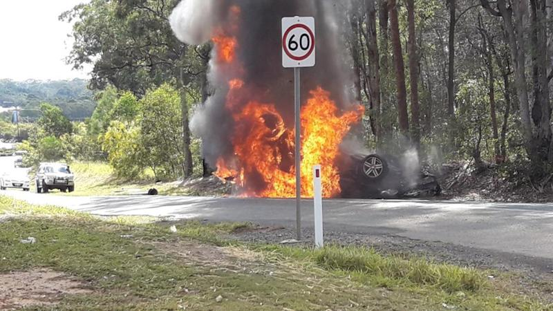 A person has died after a car crashed into a tree north of Brisbane.