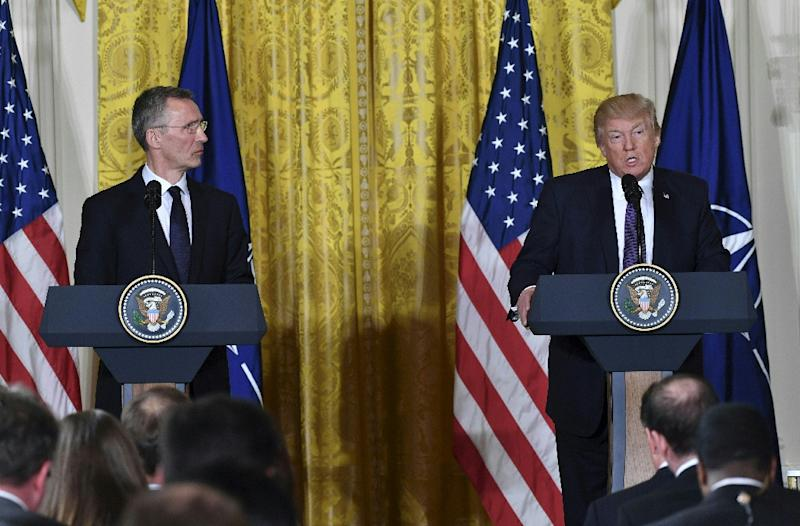 US President Donald Trump and NATO Secretary General Jens Stoltenberg (L) hold a joint press conference in the East Room at the White House in Washington, DC, on April 12, 2017 (AFP Photo/Nicholas Kamm)