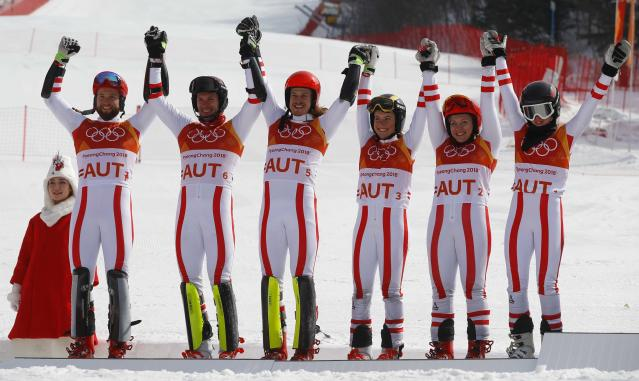 Alpine Skiing - Pyeongchang 2018 Winter Olympics - Team Event - Yongpyong Alpine Centre - Pyeongchang, South Korea - February 24, 2018 - Silver medallist Austria's team celebrates on the podium during the victory ceremony. REUTERS/Leonhard Foeger