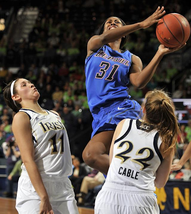 DePaul guard Jasmine Penney attempts to drive the lane as she collides with Notre Dame guard Madison Cable, right, as teammate Natalie Achonwa looks on during the second half of a NCAA college basketball game, Tuesday, Nov. 26, 2013, in South Bend, Ind. Notre Dame won 92-76. (AP Photo/Joe Raymond)