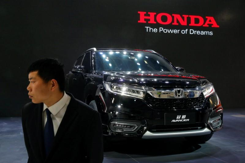 A security agent guards Honda Avancier SUV after it was presented during Auto China 2016 auto show in Beijing