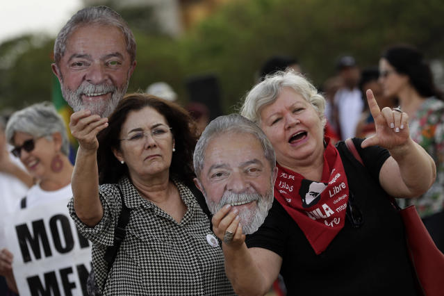 Supporters of former President Luiz Inacio Lula da Silva, shout slogans across the street from an act in support of operation Car Wash and former judge Sergio Moro, in front of Supreme Court headquarters in Brasilia, Brazil, Wednesday, Sept. 25, 2019. Brazil's Supreme Court will decide about a prisoner involved in the Car Wash operation, an anti-corruption investigation that managed to jail politicians and businessmen all over Latin America, that could open a door for others arrested during the operation, to appeal their sentences. The former president was jailed as a result of the Car Wash investigations. (AP Photo/Eraldo Peres)