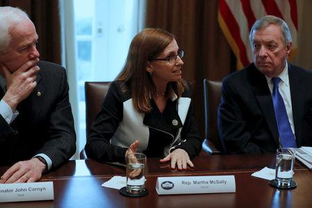 FILE PHOTO - U.S. Representative Martha McSally (R-AZ), flanked by Senator John Cornyn (R-TX) and Senator Dick Durbin (D-IL), speaks as U.S. President Donald Trump holds a bipartisan meeting with legislators on immigration reform at the White House in Washington, U.S. January 9, 2018.  REUTERS/Jonathan Ernst