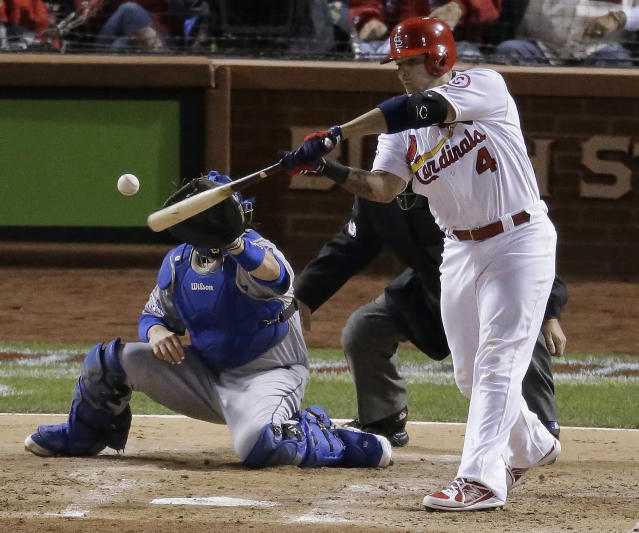 St. Louis Cardinals' Yadier Molina hits an RBI single during the third inning of Game 6 of the National League baseball championship series against the Los Angeles Dodgers, Friday, Oct. 18, 2013, in St. Louis. (AP Photo/Chris Carlson)