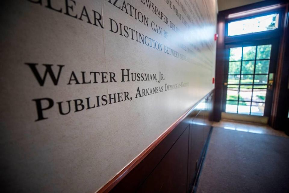 """Walter Hussman Jr.'s name appears on a """"statement of core values"""" that can be seen on the wall in the lobby of Carroll Hall in Chapel Hill, N.C., the building housing the Hussman School of Journalism and Media, pictured here on Wednesday, July 14, 2021."""