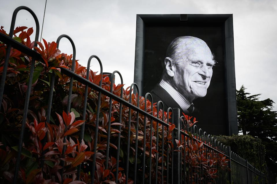 A digital billboard displays a portrait of Prince Philip, Duke of Edinburgh, who died April 9 at age 99 at Windsor Castle.
