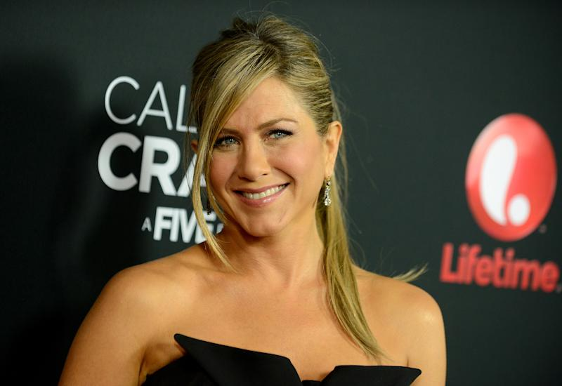 "Jennifer Aniston arrives at the world premiere of ""Call Me Crazy: A Five Film"" at the Pacific Design Center on Tuesday, April 16, 2013 in Los Angeles. (Photo by Jordan Strauss/Invision/AP)"