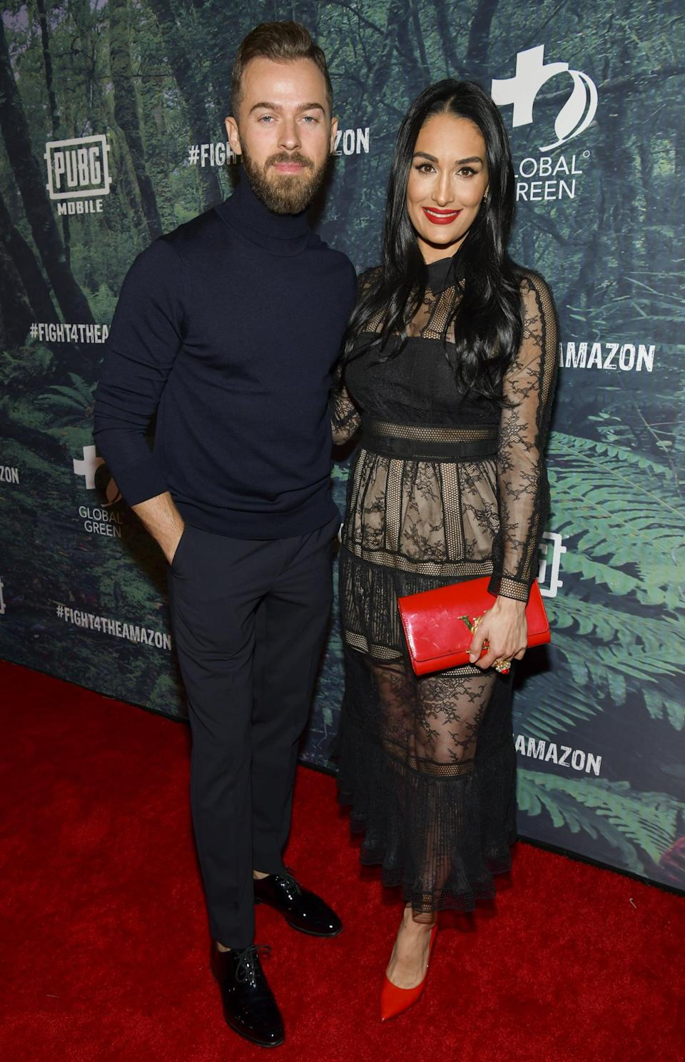 "<p>In January, the former wrestler announced that she's expecting her first child <a href=""https://www.popsugar.com/celebrity/Nikki-Bella-Artem-Chigvintsev-Dating-45955263"" class=""link rapid-noclick-resp"" rel=""nofollow noopener"" target=""_blank"" data-ylk=""slk:with fiancé Artem Chigvintsev"">with fiancé Artem Chigvintsev</a>. Her due date is only a week and a half apart from her twin sister, Brie. </p>"