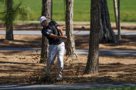 Ian Poulter, of England, hits out of the trees on the fifth hole during the first round of the The Players Championship golf tournament Thursday, March 11, 2021, in Ponte Vedra Beach, Fla. (AP Photo/John Raoux)