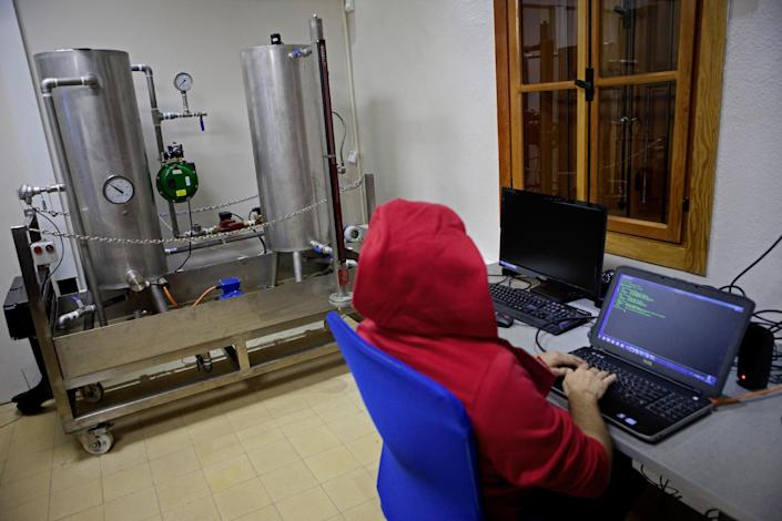 In this Tuesday Oct. 20, 2013 photo, an Israeli works on a computer at the 'CyberGym' school in the coastal city of Hadera. When Israel's military chief delivered a high-profile speech this month outlining the greatest threats his country will face in the future, he listed computer sabotage as a top concern, warning a sophisticated cyber attack could one day bring the nation to a standstill. (AP Photo/Dan Balilty)