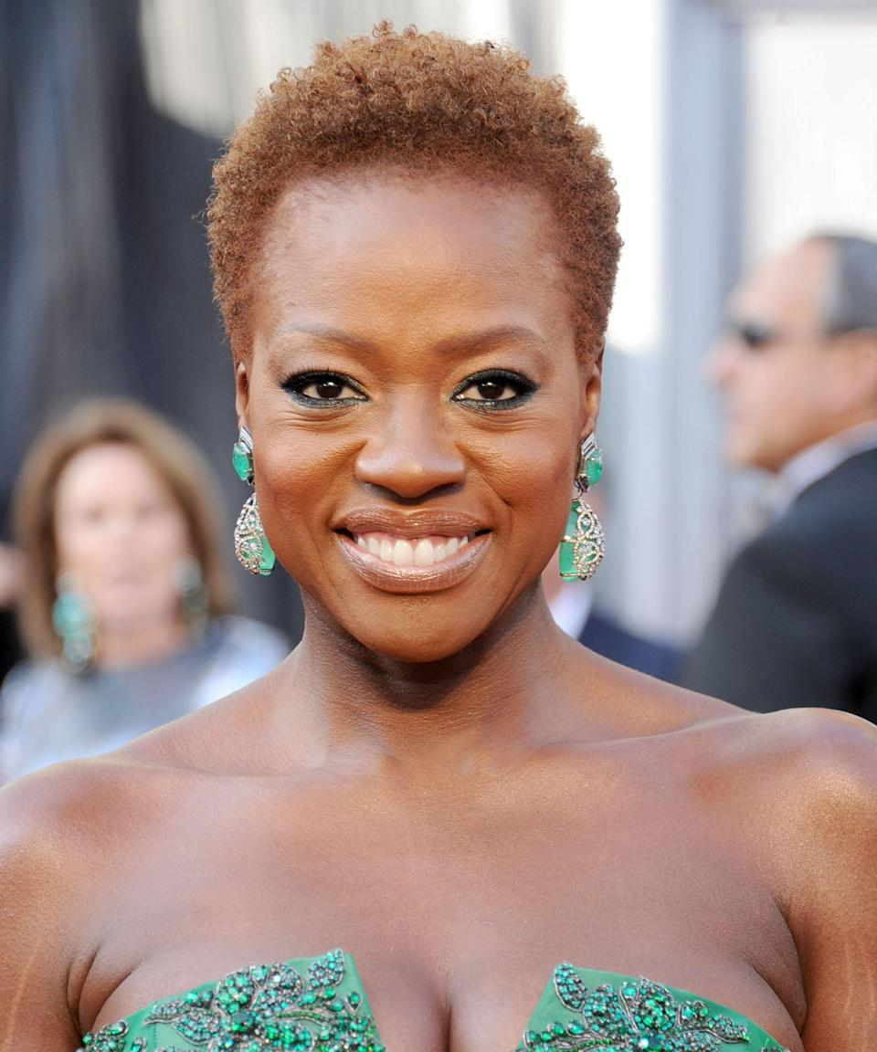 """<p><strong>Viola Davis, 2012</strong></p><p>The celebrated actress made a major statement on the 2012 red carpet by ditching her <a href=""""https://www.refinery29.com/en-us/best-wigs-for-beginners"""" rel=""""nofollow noopener"""" target=""""_blank"""" data-ylk=""""slk:wigs"""" class=""""link rapid-noclick-resp"""">wigs</a> and showing off her natural hair. """"Hair by Mae Alice Davis, my mama,"""" she said. <a href=""""https://www.refinery29.com/en-us/2017/02/142397/viola-davis-natural-hair-makeup-beauty-meaning"""" rel=""""nofollow noopener"""" target=""""_blank"""" data-ylk=""""slk:She later told us"""" class=""""link rapid-noclick-resp"""">She later told us</a> of her decision to wear her natural hair publicly that year: """"It was liberating to be on that carpet on <em>my</em> terms.""""</p><span class=""""copyright"""">Photo: Gregg DeGuire/Getty Images.</span>"""