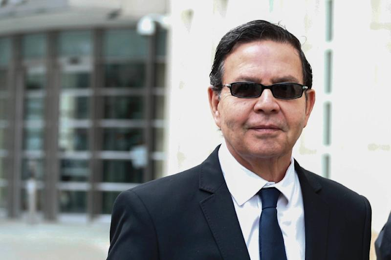 Former Honduran president Rafael Callejas leaves the Brooklyn federal court in New York, March 28, 2016 after pleading guilty to charges of racketeering conspiracy and wire fraud conspiracy in connection with the FIFA corruption scandal (AFP Photo/Kena Betancur)