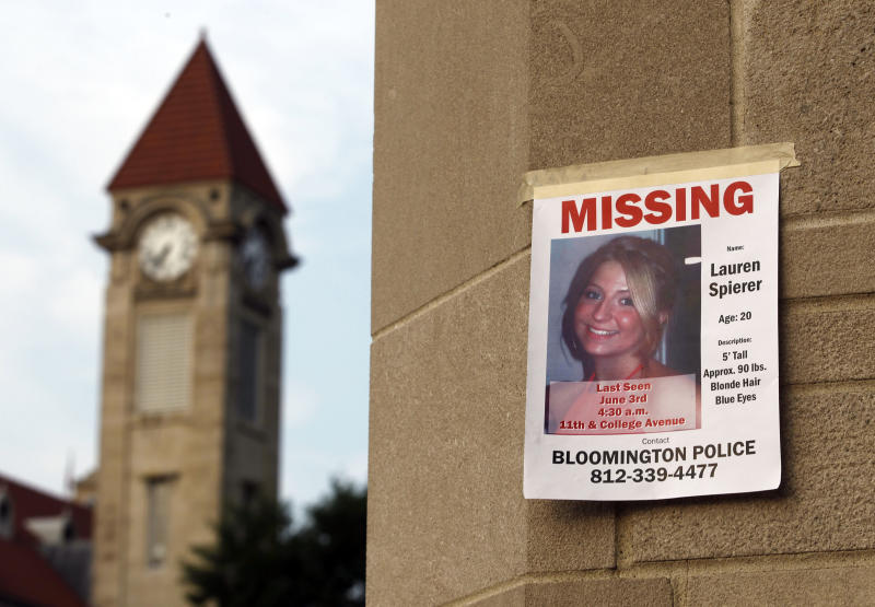 A missing person poster of Lauren Spierer, 20, is posted on one of the entry gates to Indiana University in Bloomington, Ind., Wednesday, June 8, 2011.  Spierer disappeared around 4:30 am on Friday.  Police say they suspect foul play in the disappearance of a 20-year-old Indiana University student, but have little information about what happened to her. (AP Photo/Michael Conroy)