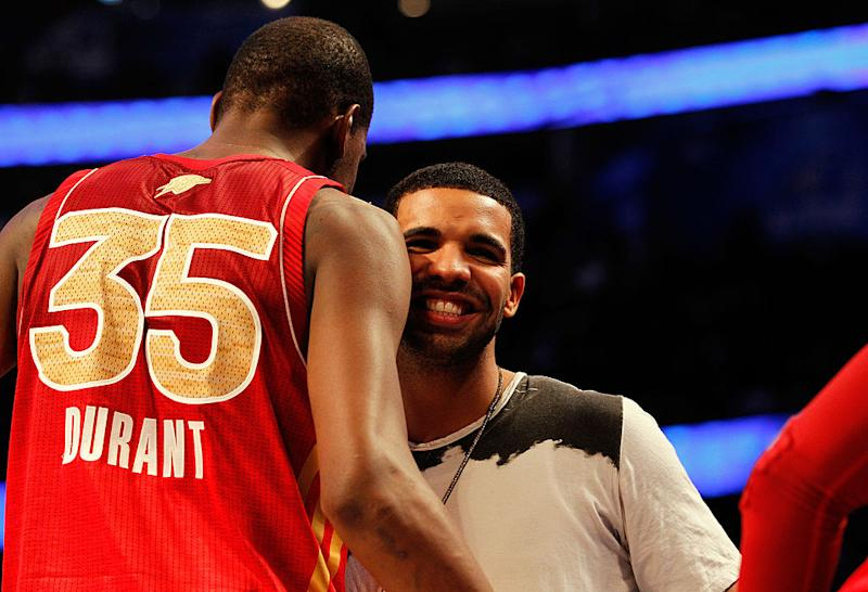 Hip-hop artist Drake greets Kevin Durant and the Western Conference during the 2012 NBA All-Star Game at the Amway Center on Feb. 26, 2012 in Orlando, Fla. (Ronald Martinez/Getty Images)