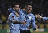 Uruguay's Gaston Pereiro, left, celebrates with teammate Uruguay's Sebastian Coates after scoring his side's opening goal against Ecuador during a qualifying soccer match for the FIFA World Cup Qatar 2022 at Campeon del Siglo stadium in Montevideo, Uruguay, Thursday, Sept.9, 2021. (Raul Martinez/Pool via AP)