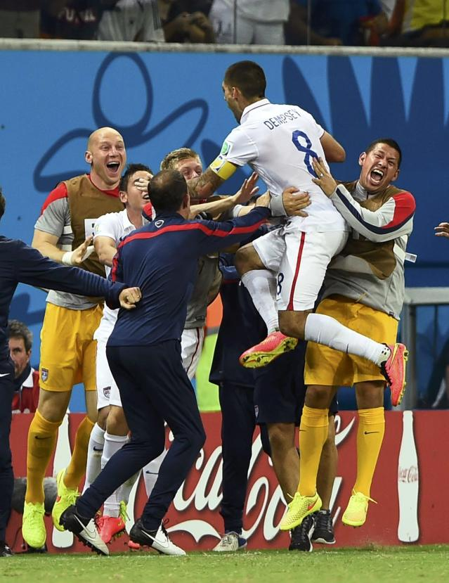 Clint Dempsey of the U.S. (2nd R) celebrates after scoring a goal with teammates during their 2014 World Cup G soccer match against Portugal at the Amazonia arena in Manaus June 22, 2014. REUTERS/Dylan Martinez (BRAZIL - Tags: SOCCER SPORT WORLD CUP)