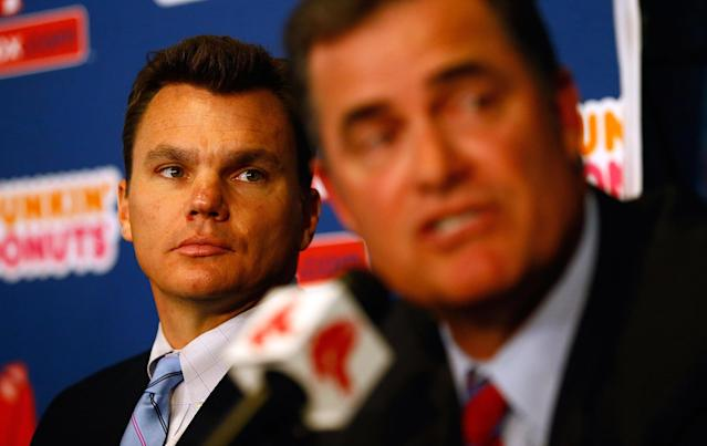 BOSTON, MA - OCTOBER 23: Executive Vice President and General Manager of the Boston Red Sox, Ben Cherington (L), listens after introducing John Farrell as the new manager, the 46th manager in the club's 112-year history, on October 23, 2012 at Fenway Park in Boston, Massachusetts. (Photo by Jared Wickerham/Getty Images)