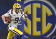 FILE - In this Dec. 7, 2019, file photo, LSU quarterback Joe Burrow (9) runs against Georgia during the second half of the Southeastern Conference championship NCAA college football game, in Atlanta. Burrow is a unanimous selection as the offensive player of the year on The Associated Press All-Southeastern Conference football team, Monday, Dec. 9, 2019. (AP Photo/Mike Stewart, File)