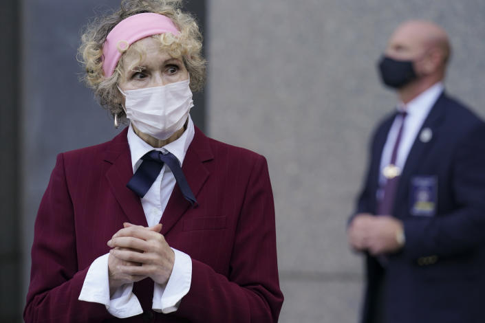 E. Jean Carroll, who says President Donald Trump raped her in the 1990s, leaves the Daniel Patrick Moynihan United States Courthouse following a hearing in her defamation lawsuit against Trump, Wednesday, Oct. 21, 2020, in New York. (AP Photo/John Minchillo)