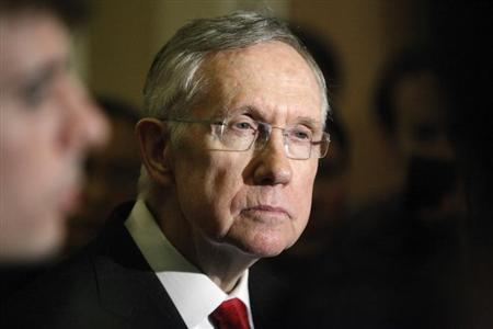 Reid answers questions from reporters after the weekly Republican caucus luncheon at the U.S. Capitol in Washington