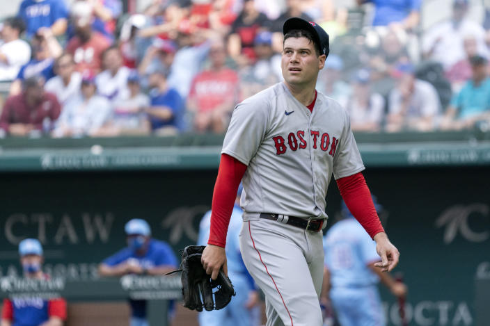 FILE - In this May 2, 2021, file photo, Boston Red Sox relief pitcher Adam Ottavino walks to the dugout after being pulled during the eighth inning of a baseball game against the Texas Rangers in Arlington, Texas. When the Brooklyn-based 78 Youth Sports program was struggling, it put out a call to its most famous alum. Ottavino helped the organization that started him off in baseball raise as much as $20,000 so far to rebuild from a post-pandemic hole that almost drove it to bankruptcy. (AP Photo/Jeffrey McWhorter, File)