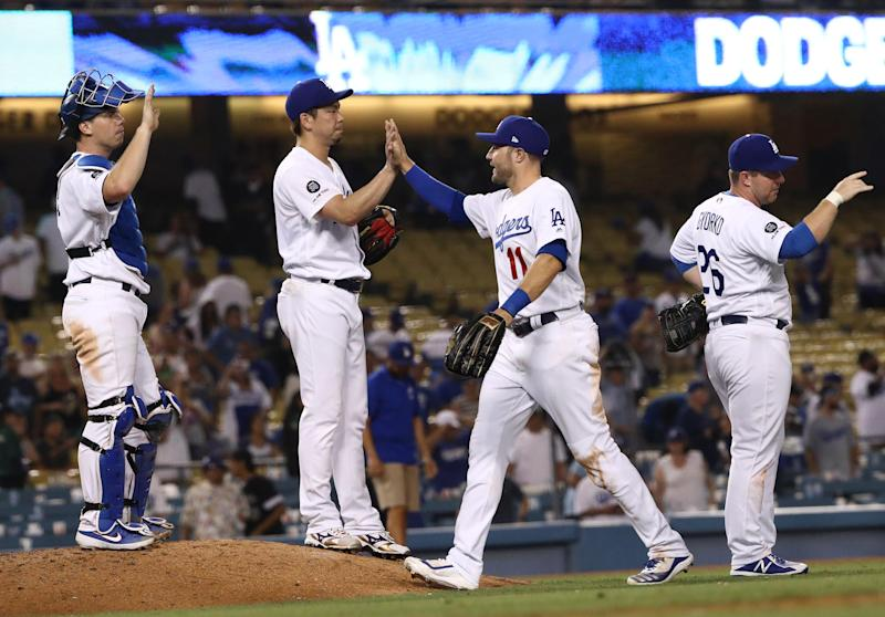 LOS ANGELES, CALIFORNIA - SEPTEMBER 02: (L-R) Catcher Will Smith #16, pitcher Kenta Maeda #18, A.J. Pollock #11 and Jedd Gyorko #26 of the Los Angeles Dodgers celebrate after the MLB game against the Colorado Rockies at Dodger Stadium on September 02, 2019 in Los Angeles, California. The Dodgers defeated the Rockies 16-9. (Photo by Victor Decolongon/Getty Images)