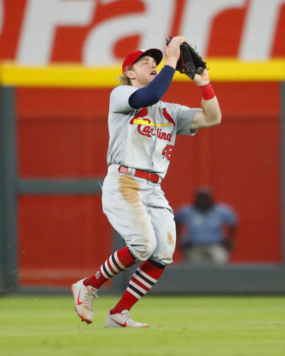 St. Louis Cardinals center fielder Harrison Bader makes the catch on a ball hit by Atlanta Braves' Nick Markakis for the final out of a baseball game Tuesday, Sept. 18, 2018, in Atlanta. The Cardinals won 8-1. (AP Photo/Todd Kirkland)