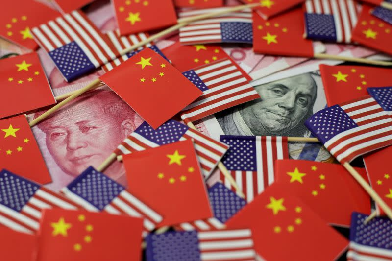 FILE PHOTO: FILE PHOTO: Illustration picture showing U.S. dollar and China's yuan banknotes