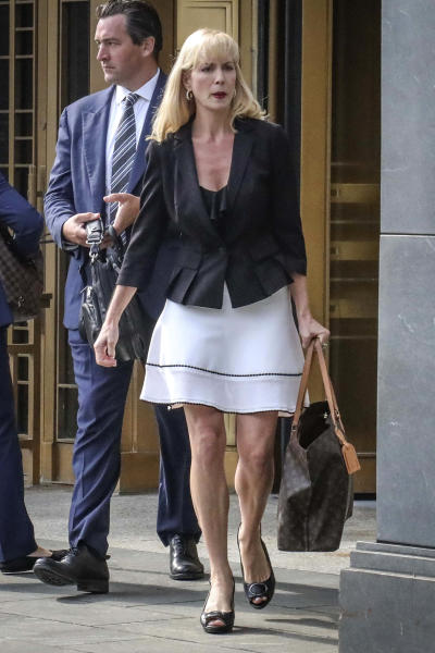 Sigrid McCawley, attorney for alleged sexual abuse victims of financier Jeffrey Epstein who committed suicide while awaiting trial, leaves after a hearing in Manhattan Federal Court to discuss plans for unsealing more court records for a civil case against Epstein, Wednesday Sept. 4, 2019, in New York. (AP Photo/Bebeto Matthews)