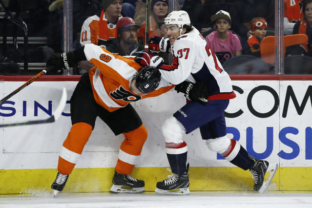Philadelphia Flyers' Ivan Provorov, left, and Washington Capitals' T.J. Oshie get tangled up during the first period of an NHL hockey game, Wednesday, Nov. 13, 2019, in Philadelphia. (AP Photo/Matt Slocum)