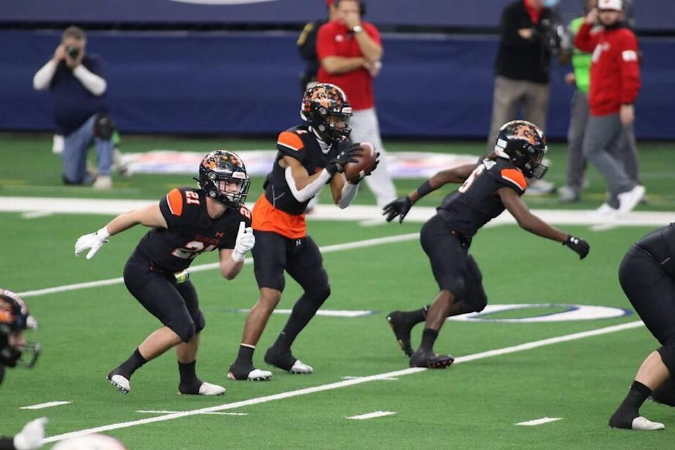 Aledo senior fullback Gatlin Johnson (left) was first team all district and helped the Bearcats win state.