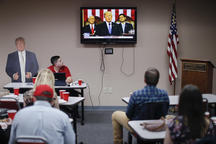 Supporters watch President Trump speak at a State of the Union watch party hosted by the Hamilton County Republican Party in Cincinnati on Tuesday. (AP Photo/John Minchillo)