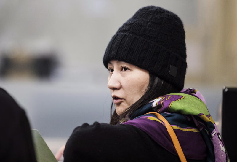 Huawei chief financial officer Meng Wanzhou arrives at a parole office in Vancouver, British Columbia, Wednesday, Dec. 12, 2018. (Darryl Dyck/The Canadian Press via AP)
