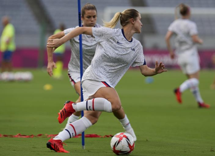 United States' Abby Dahlkemper warms up before a women's soccer match against Sweden at the 2020 Summer Olympics, Wednesday, July 21, 2021, in Tokyo. (AP Photo/Ricardo Mazalan)